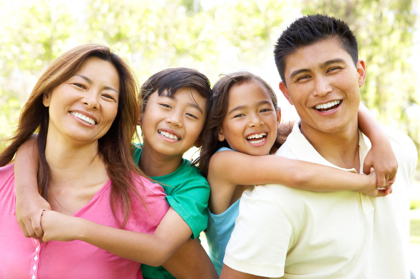 Image of family smiling