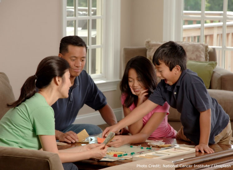 A family playing monopoly.