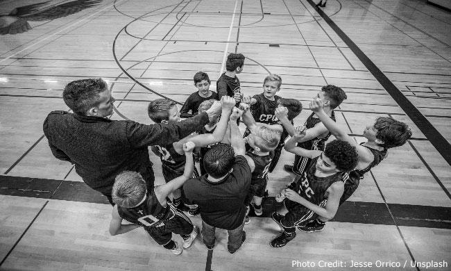 Boy's basketball team with coach